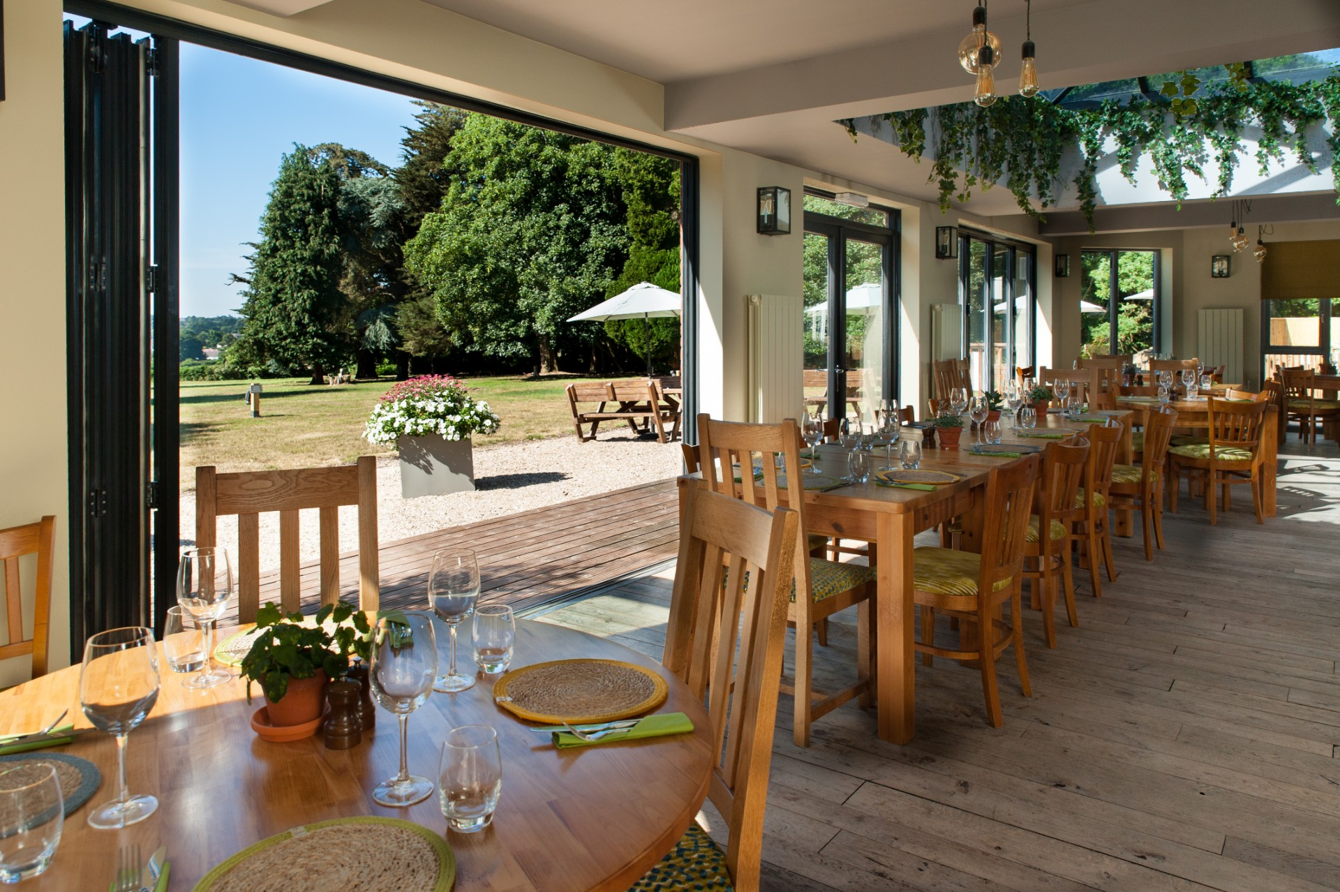 Dining seating with views of the grounds at the pear at parley bar and restaurant in west parley, ferndown, dorset